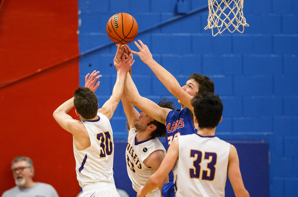 Pleasant Plains' Joel Niermann (30) goes for a rebound against Williamsville's Joseph Mitchell (13) in the first half during the championship game of the Sangamon County Tournament at Cass Gymnasium, Friday, Jan. 13, 2017, in Springfield, Ill. Justin L. Fowler/The State Journal-Register