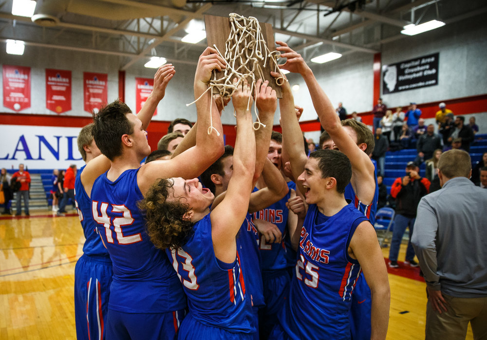 ]Pleasant Plains' Cole Greer (13) along with Pleasant Plains' Isaac Collins (25) celebrate with their teammates after defeating Williamsville in the championship game of the Sangamon County Tournament at Cass Gymnasium, Friday, Jan. 13, 2017, in Springfield, Ill. Justin L. Fowler/The State Journal-Register