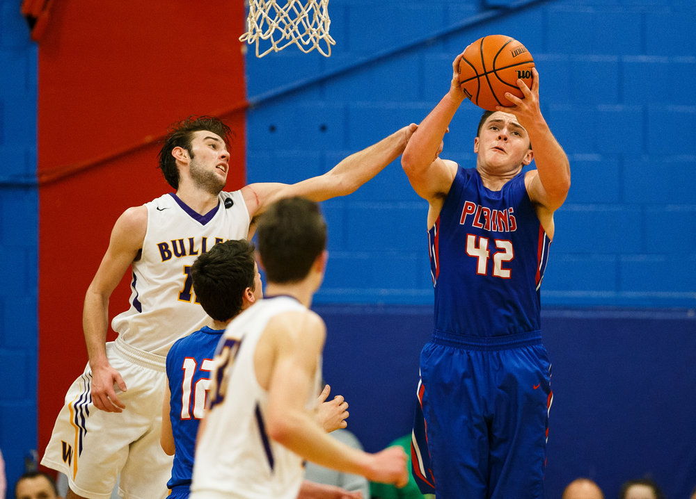 Pleasant Plains' Nik Clemens (42) pulls in a rebound against Williamsville's Joseph Mitchell (13) in the second half during the championship game of the Sangamon County Tournament at Cass Gymnasium, Friday, Jan. 13, 2017, in Springfield, Ill. Justin L. Fowler/The State Journal-Register