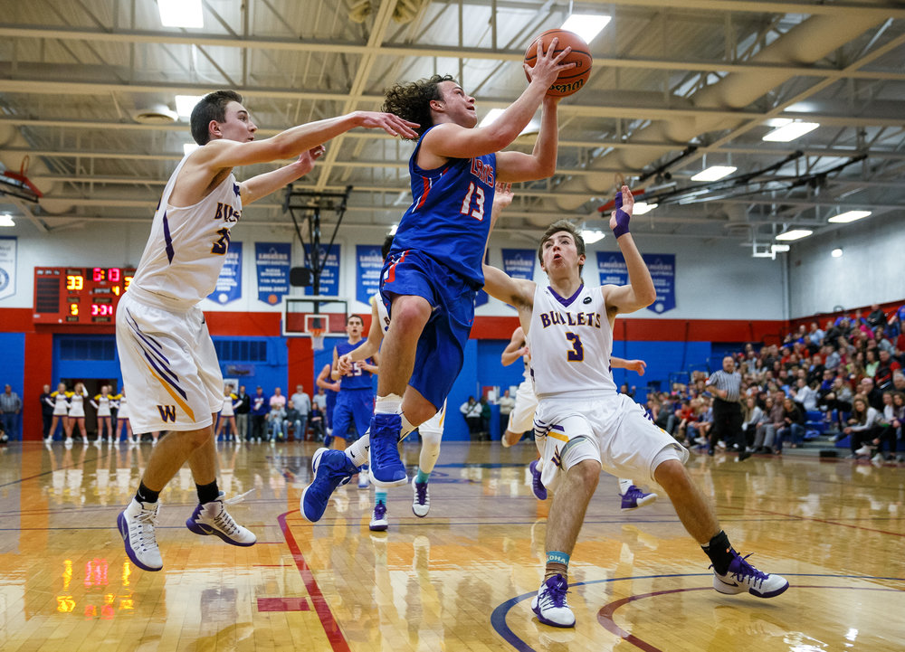 Pleasant Plains' Cole Greer (13) drives past Williamsville's Casey Tuttle (30) as he goes up for a basket in the second half during the championship game of the Sangamon County Tournament at Cass Gymnasium, Friday, Jan. 13, 2017, in Springfield, Ill. Justin L. Fowler/The State Journal-Register