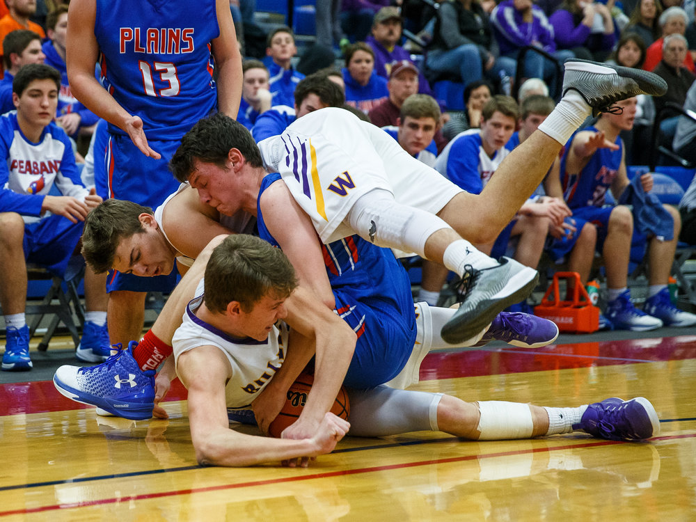 Williamsville's Kenton Baskett (10) and Pleasant Plains' TJ Painter (12) hit the floor going for a loose ball in the second half during the championship game of the Sangamon County Tournament at  Cass Gymnasium, Friday, Jan. 13, 2017, in Springfield, Ill. Justin L. Fowler/The State Journal-Register