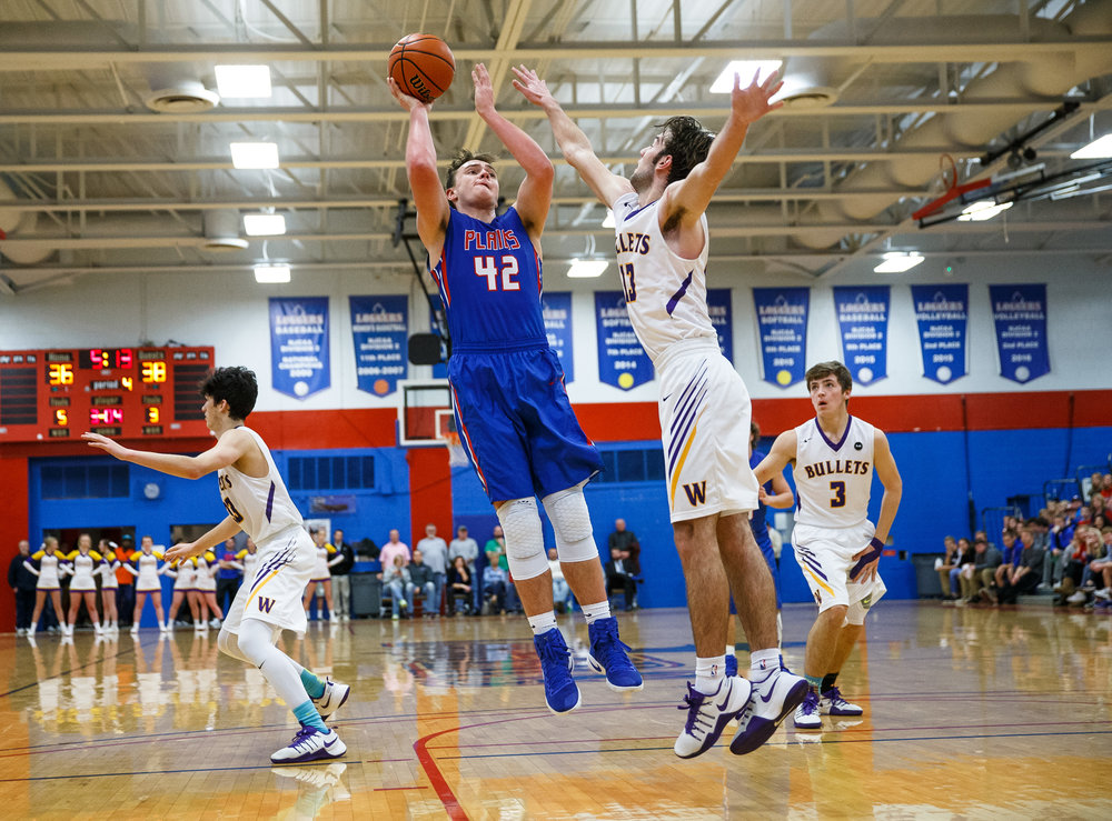 Pleasant Plains' Nik Clemens (42) puts up a shot over Williamsville's Joseph Mitchell (13) in the second half during the championship game of the Sangamon County Tournament at  Cass Gymnasium, Friday, Jan. 13, 2017, in Springfield, Ill. Justin L. Fowler/The State Journal-Register