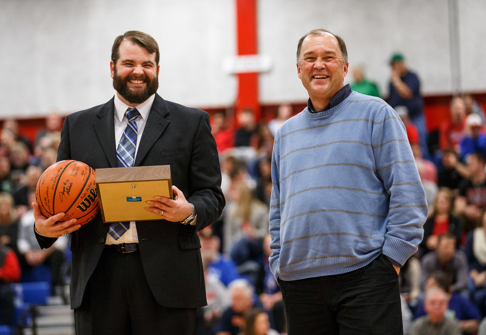"State Journal-Register sports reporter Dave Kane is awarded the ""Friend of the County"" award by Auburn High School principal Nathan Essex, left, prior to the championship game of the Sangamon County Tournament at Cass Gymnasium, Friday, Jan. 13, 2017, in Springfield, Ill. Justin L. Fowler/The State Journal-Register"