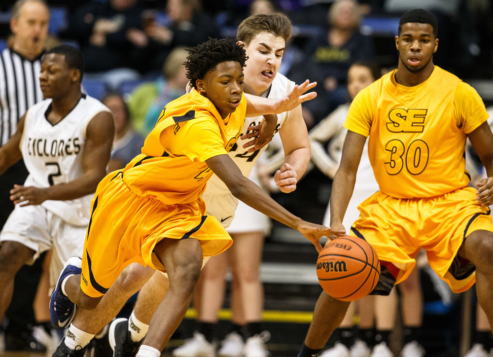 Southeast's Terrion Murdix (4)  tries grab possession of the ball against Sacred Heart-Griffin's Nick Broeker (24) in the second quarter of the Boys City Basketball Tournament at the Prairie Capital Convention Center, Thursday, Jan. 19, 2017, in Springfield, Ill. Justin L. Fowler/The State Journal-Register