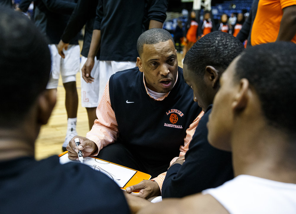 Lanphier boys basketball head coach Blake Turner talks to his starters on the bench prior to the Lions taking on Springfield in the Boys City Basketball Tournament at the Prairie Capital Convention Center, Thursday, Jan. 19, 2017, in Springfield, Ill. Justin L. Fowler/The State Journal-Register