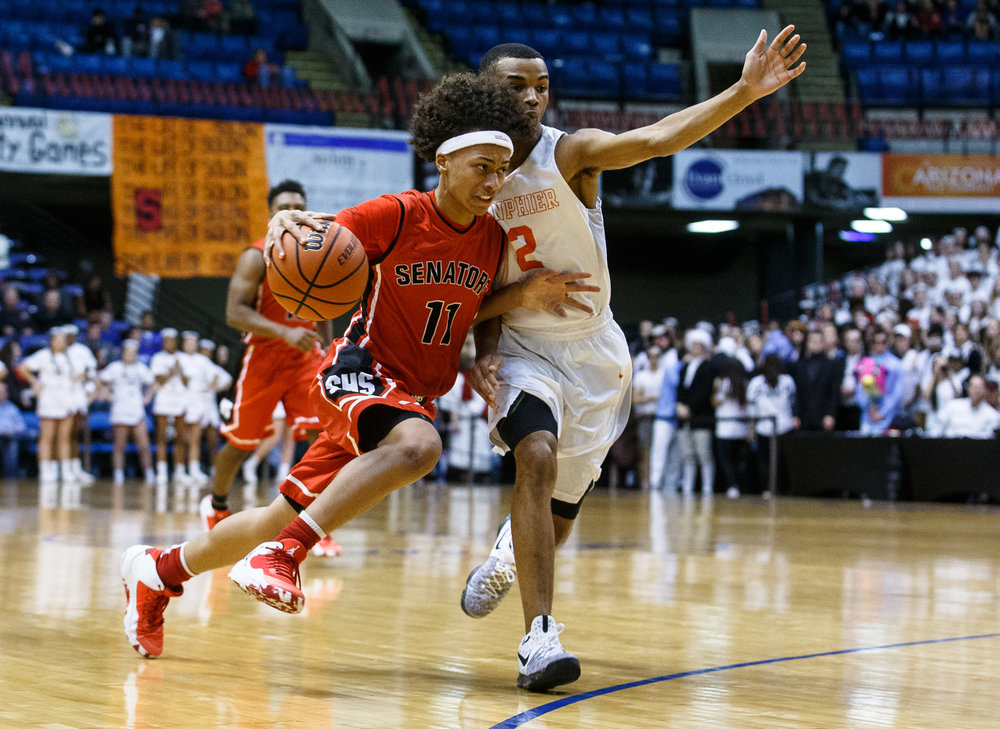 Springfield's Zaire Harris (11) drives towards the basket against Lanphier's Cardell McGee (2) in the first quarter of the Boys City Basketball Tournament at the Prairie Capital Convention Center, Thursday, Jan. 19, 2017, in Springfield, Ill. Justin L. Fowler/The State Journal-Register