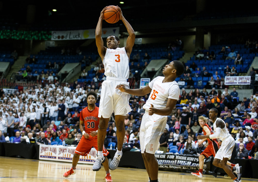 Lanphier's Aundrae Williams (3) goes up for a rebound against Springfield in the first quarter of the Boys City Basketball Tournament at the Prairie Capital Convention Center, Thursday, Jan. 19, 2017, in Springfield, Ill. Justin L. Fowler/The State Journal-Register