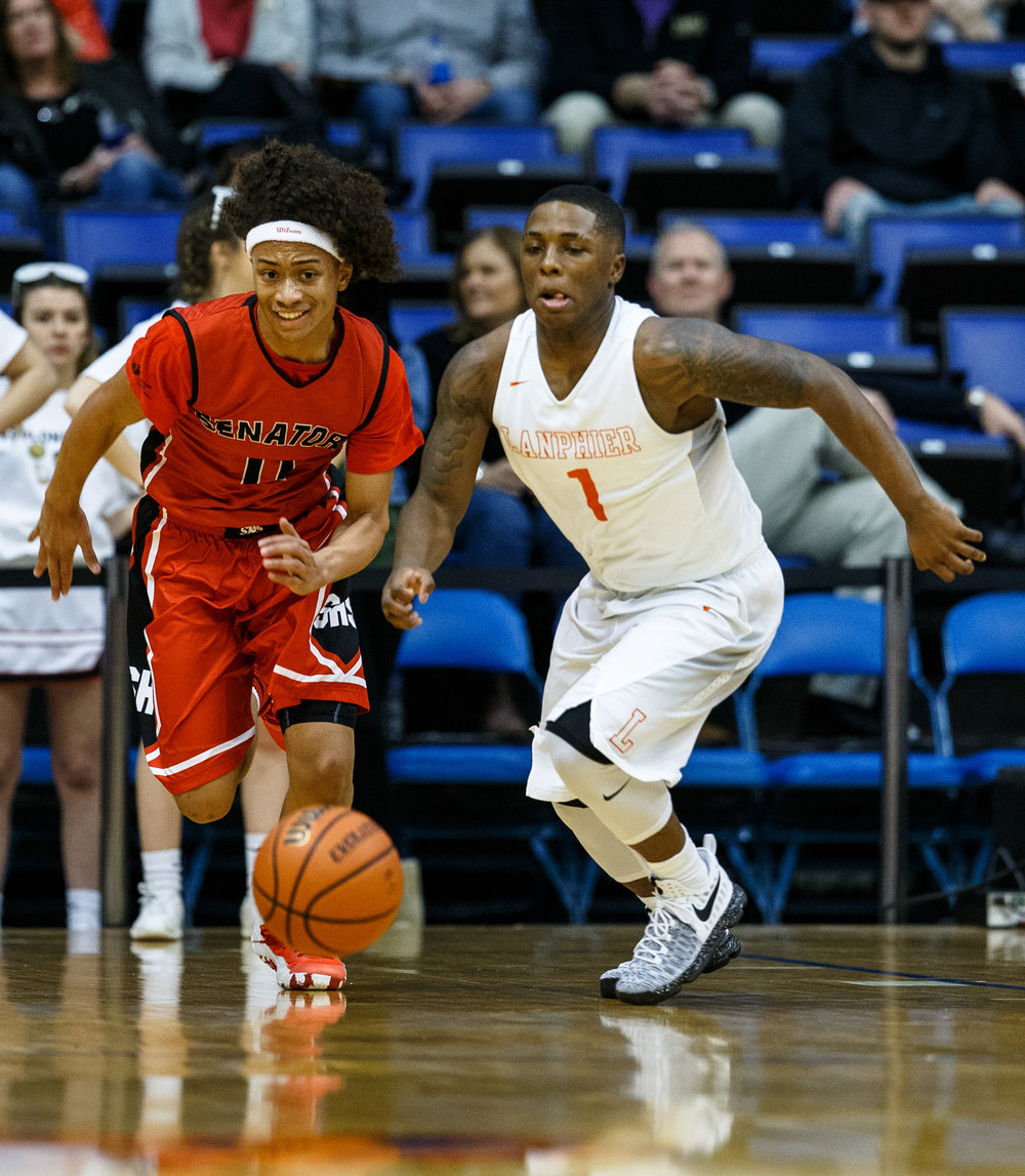 Lanphier's Yaakema Rose (1) and Springfield's Zaire Harris (11) go after a loose ball in the second quarter of the Boys City Basketball Tournament at the Prairie Capital Convention Center, Thursday, Jan. 19, 2017, in Springfield, Ill. Justin L. Fowler/The State Journal-Register