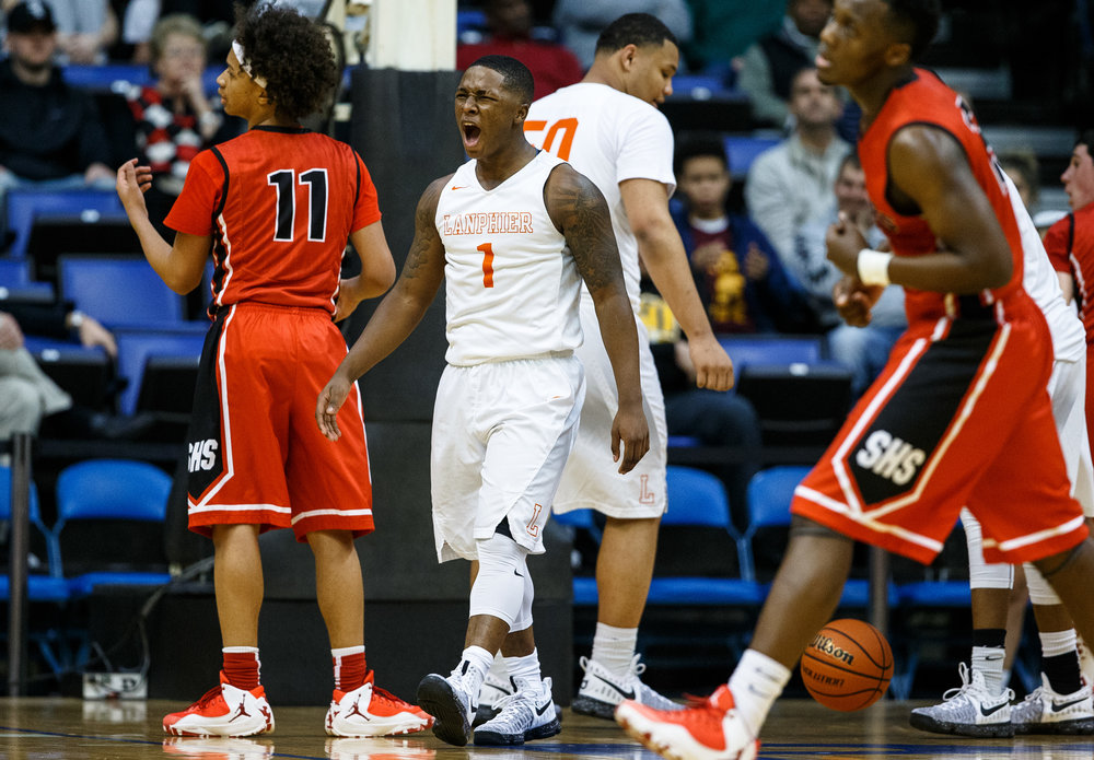 Lanphier's Yaakema Rose (1) screams out after drawing the foul while going up for a basket against Springfield in the second quarter of the Boys City Basketball Tournament at the Prairie Capital Convention Center, Thursday, Jan. 19, 2017, in Springfield, Ill. Justin L. Fowler/The State Journal-Register