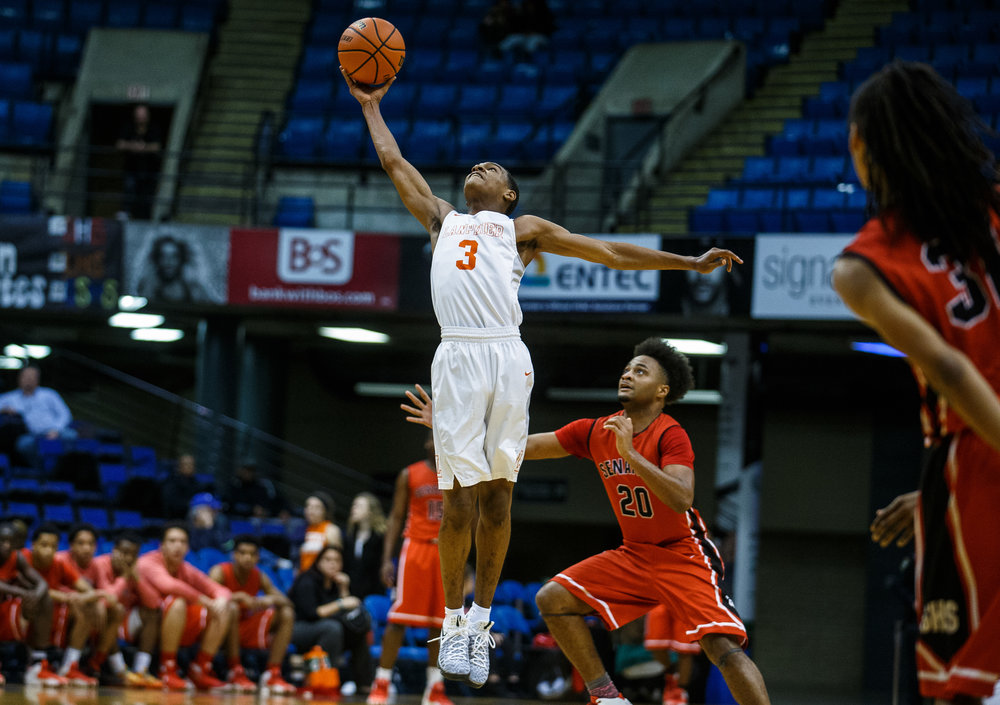 Lanphier's Aundrae Williams (3) leaps up to steal a pass out of the air against Springfield's Rahkeem Hawkins (20) in the third quarter of the Boys City Basketball Tournament at the Prairie Capital Convention Center, Thursday, Jan. 19, 2017, in Springfield, Ill. Justin L. Fowler/The State Journal-Register