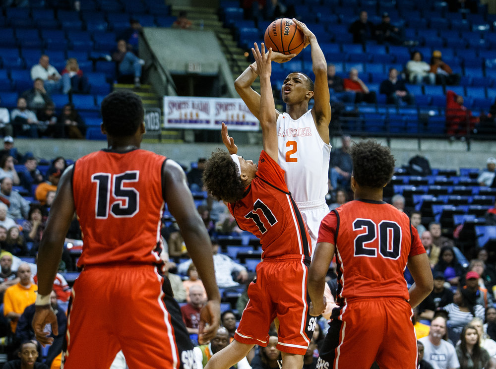 Lanphier's Cardell McGee (2) puts up a shot against Springfield's Zaire Harris (11) in the third quarter of the Boys City Basketball Tournament at the Prairie Capital Convention Center, Thursday, Jan. 19, 2017, in Springfield, Ill. Justin L. Fowler/The State Journal-Register