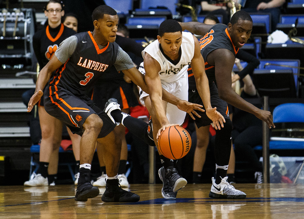 Lanphier's Aundrae Williams (3) and Sacred Heart-Griffin's Spencer Redd (10) go after a loose ball in the first quarter of the Boys City Basketball Tournament at the Prairie Capital Convention Center, Friday, Jan. 20, 2017, in Springfield, Ill. Justin L. Fowler/The State Journal-Register