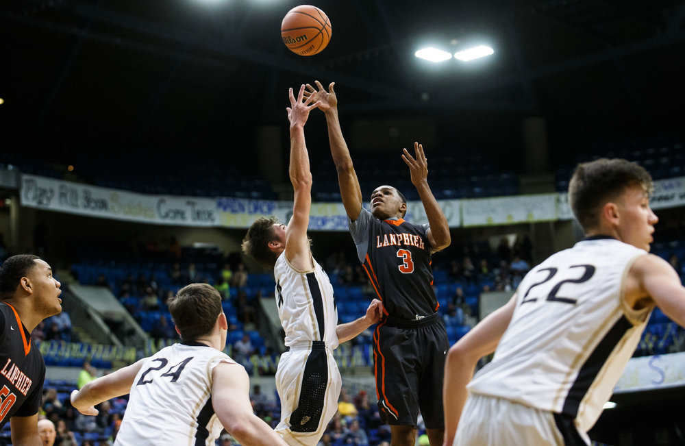 Lanphier's Aundrae Williams (3) is fouled by Sacred Heart-Griffin's Jack O'Connor (4) as he puts up a shot in the first quarter of the Boys City Basketball Tournament at the Prairie Capital Convention Center, Friday, Jan. 20, 2017, in Springfield, Ill. Justin L. Fowler/The State Journal-Register