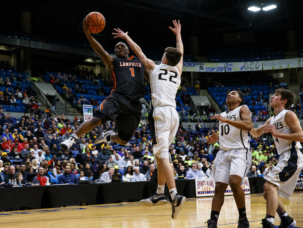 Lanphier's Yaakema Rose (1) goes up to the basket against Sacred Heart-Griffin's Jaden Snodgrass (22) in the first quarter of the Boys City Basketball Tournament at the Prairie Capital Convention Center, Friday, Jan. 20, 2017, in Springfield, Ill. Justin L. Fowler/The State Journal-Register