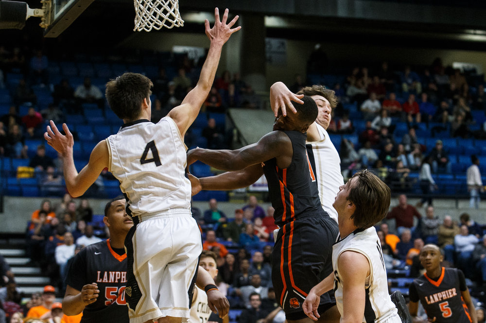 Lanphier's Yaakema Rose (1) draws the foul from Sacred Heart-Griffin's Austin Chapman (33) in the fourth quarter of the Boys City Basketball Tournament at the Prairie Capital Convention Center, Friday, Jan. 20, 2017, in Springfield, Ill. Justin L. Fowler/The State Journal-Register