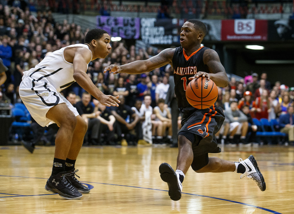 Lanphier's Yaakema Rose (1) drives to the basket against Sacred Heart-Griffin's Spencer Redd (10) in the fourth quarter of the Boys City Basketball Tournament at the Prairie Capital Convention Center, Friday, Jan. 20, 2017, in Springfield, Ill. Justin L. Fowler/The State Journal-Register