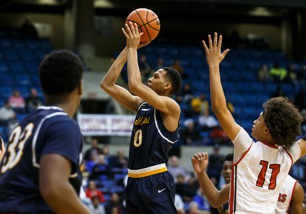 Southeast's Isaiah Walton (10) puts up a floater over Springfield in the first quarter of the Boys City Basketball Tournament at the Prairie Capital Convention Center, Friday, Jan. 20, 2017, in Springfield, Ill. Justin L. Fowler/The State Journal-Register