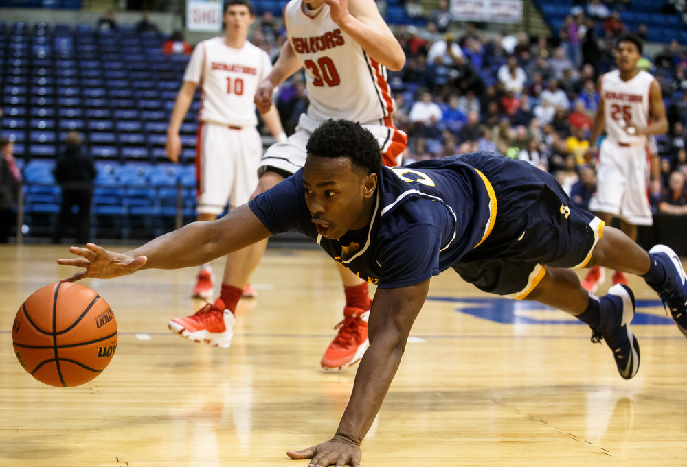Southeast's Mark Johnson (33) dives for a loose ball against Springfield in the first quarter of the Boys City Basketball Tournament at the Prairie Capital Convention Center, Friday, Jan. 20, 2017, in Springfield, Ill. Justin L. Fowler/The State Journal-Register