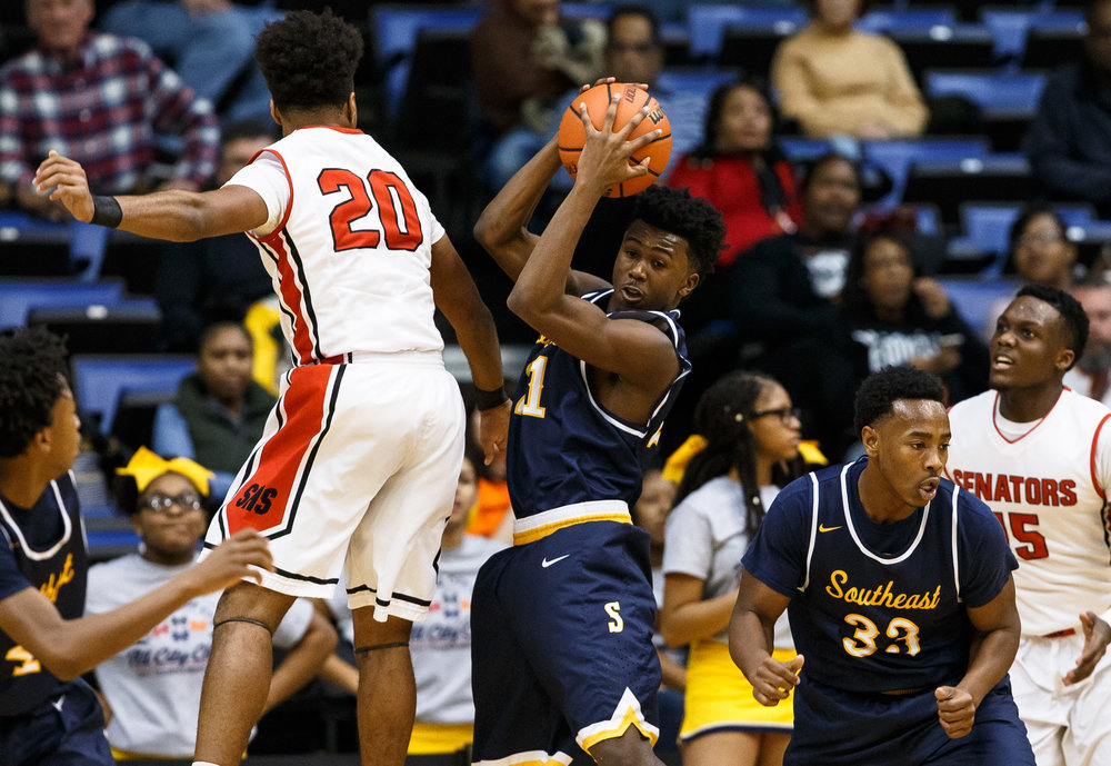 Southeast's Anthony Fairlee (21) pulls in a rebound against Springfield's Rahkeem Hawkins (20) in the first quarter of the Boys City Basketball Tournament at the Prairie Capital Convention Center, Friday, Jan. 20, 2017, in Springfield, Ill. Justin L. Fowler/The State Journal-Register