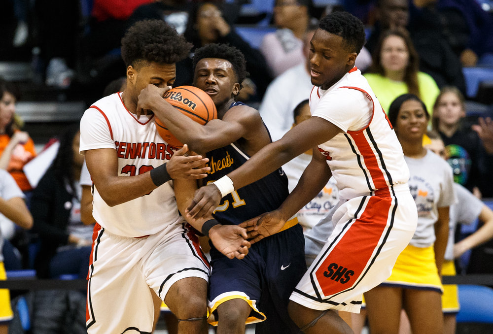 Southeast's Anthony Fairlee (21) battles for possession of the ball against Springfield's Rahkeem Hawkins (20) and Springfield's Ananise Mackey (15) in the first quarter of the Boys City Basketball Tournament at the Prairie Capital Convention Center, Friday, Jan. 20, 2017, in Springfield, Ill. Justin L. Fowler/The State Journal-Register