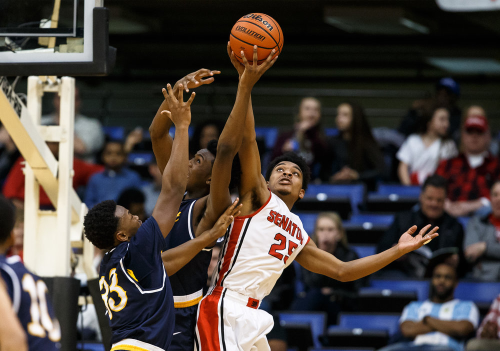 Springfield's Josh Washington (25) goes for a rebound against Southeast's Anthony Fairlee (21) in the third quarter of the Boys City Basketball Tournament at the Prairie Capital Convention Center, Friday, Jan. 20, 2017, in Springfield, Ill. Justin L. Fowler/The State Journal-Register