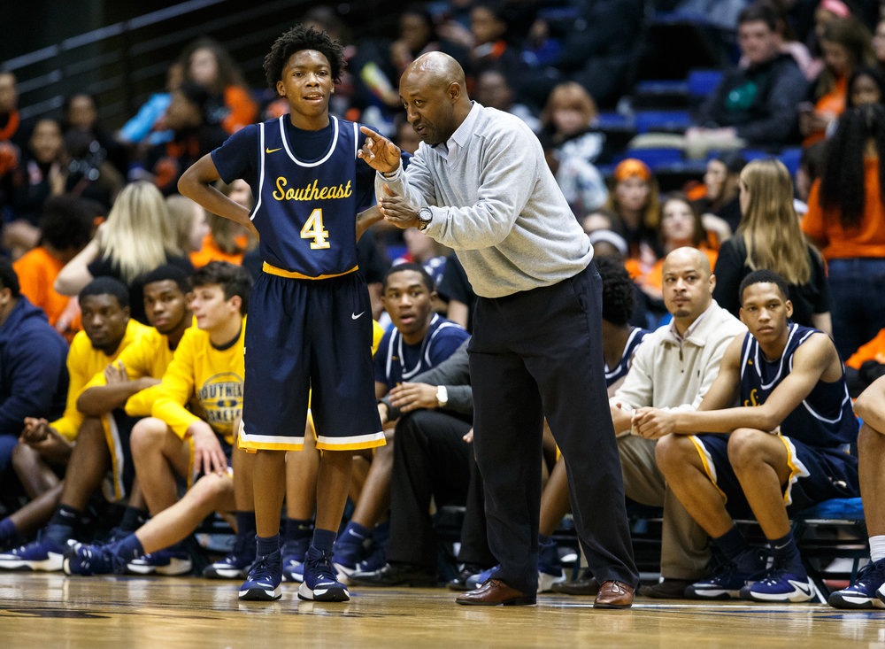 Southeast assistant coach Chuck Shanklin talks with Southeast's Terrion Murdix (4) along the sidelines as the Spartans take on Springfield in the second quarter of the Boys City Basketball Tournament at the Prairie Capital Convention Center, Friday, Jan. 20, 2017, in Springfield, Ill. Justin L. Fowler/The State Journal-Register