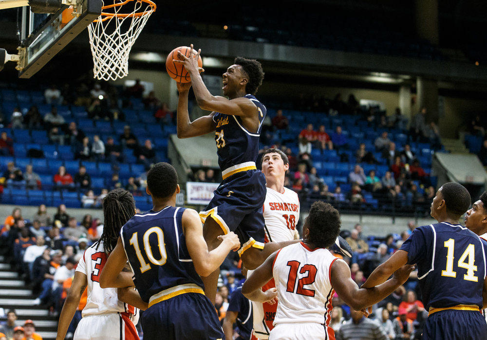 Southeast's Anthony Fairlee (21) goes up for the basket for a shot against Springfield's Trevor Minder (10) in the third quarter of the Boys City Basketball Tournament at the Prairie Capital Convention Center, Friday, Jan. 20, 2017, in Springfield, Ill. Justin L. Fowler/The State Journal-Register