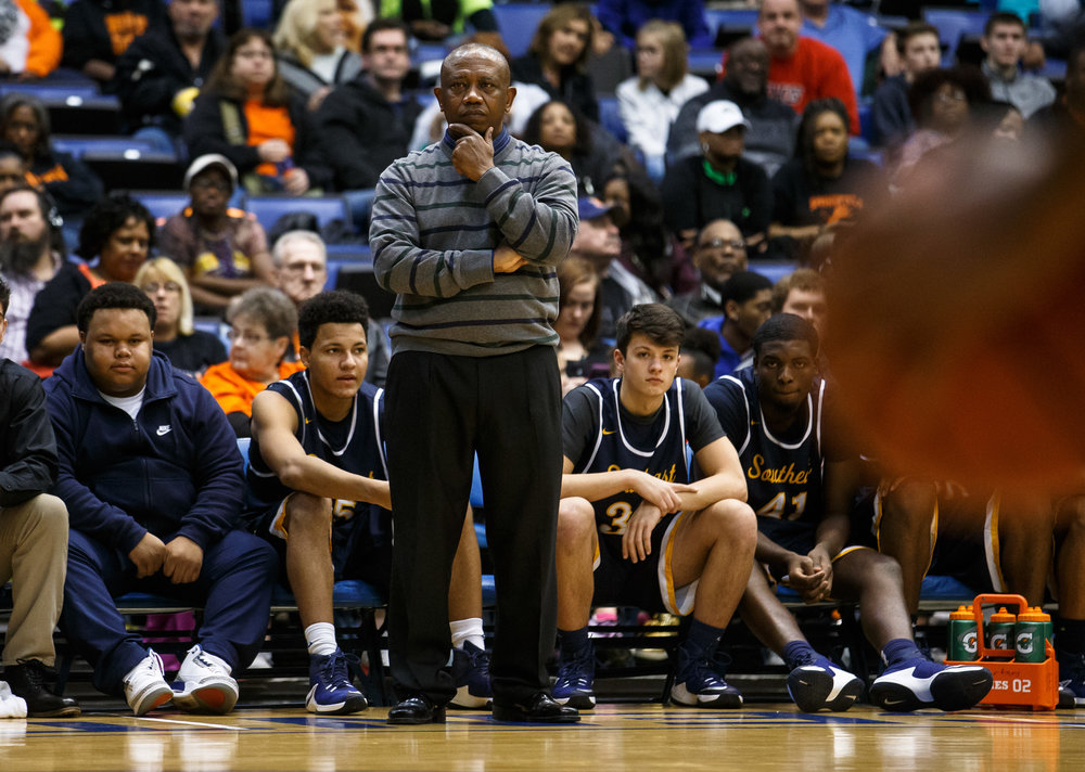Southeast boys basketball head coach Lawrence Thomas watches as the Spartans take on Springfield in the third quarter of the Boys City Basketball Tournament at the Prairie Capital Convention Center, Friday, Jan. 20, 2017, in Springfield, Ill. Justin L. Fowler/The State Journal-Register