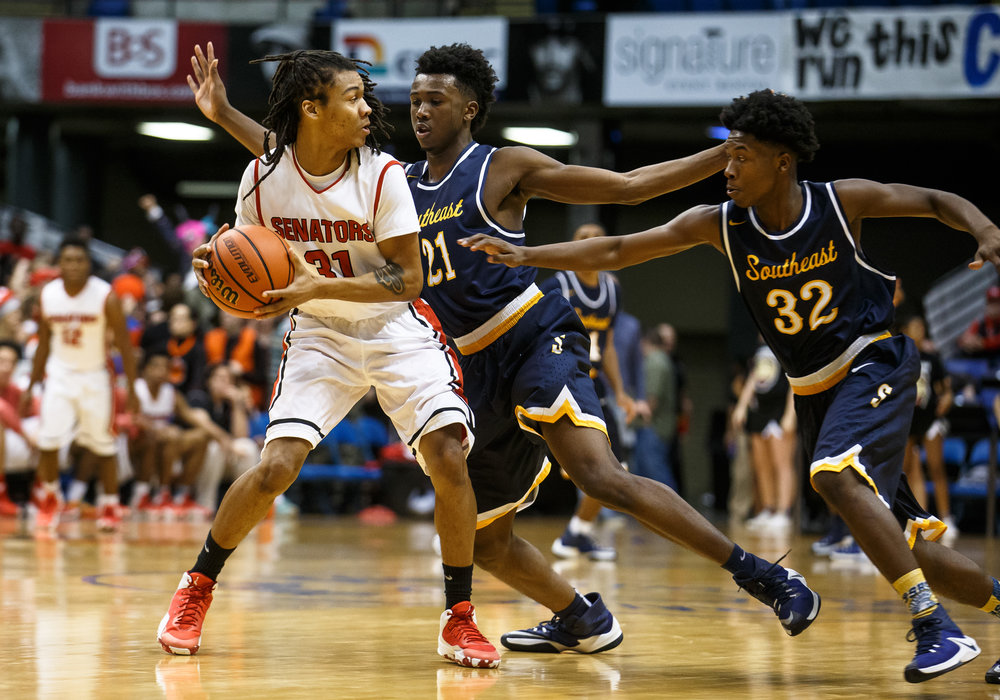 Southeast's Anthony Fairlee (21) and Southeast's Stepheon Sims (32) press Springfield's D'Andre Perkins (31) in the third quarter of the Boys City Basketball Tournament at the Prairie Capital Convention Center, Friday, Jan. 20, 2017, in Springfield, Ill. Justin L. Fowler/The State Journal-Register