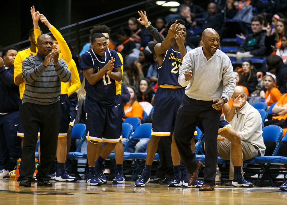 The Southeast bench erupts after the Spartans force a Springfield turnover in the second quarter of the Boys City Basketball Tournament at the Prairie Capital Convention Center, Friday, Jan. 20, 2017, in Springfield, Ill. Justin L. Fowler/The State Journal-Register