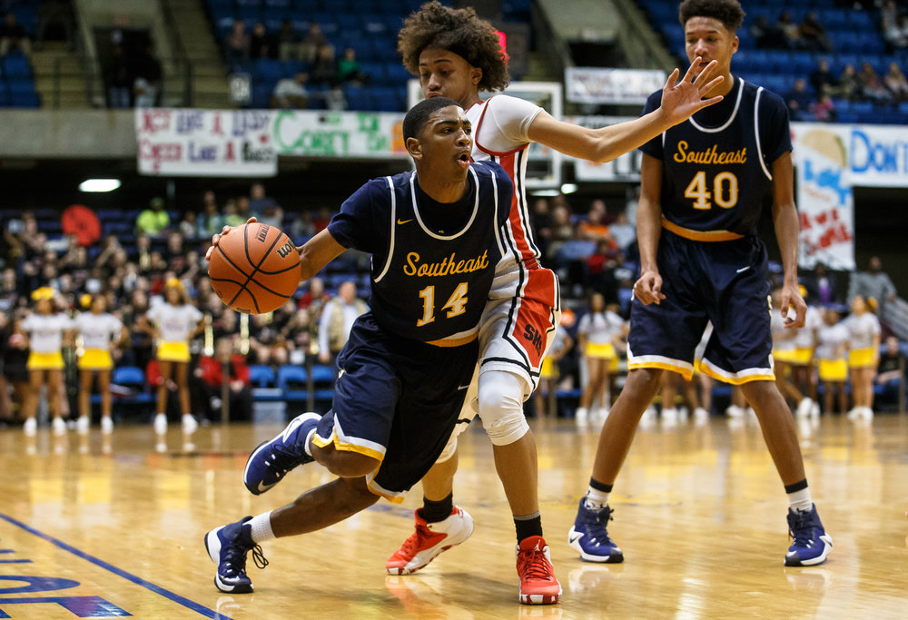Southeast's Trevyon Williams (14) drives towards the basket against Springfield's Zaire Harris (11) in the second quarter of the Boys City Basketball Tournament at the Prairie Capital Convention Center, Friday, Jan. 20, 2017, in Springfield, Ill. Justin L. Fowler/The State Journal-Register
