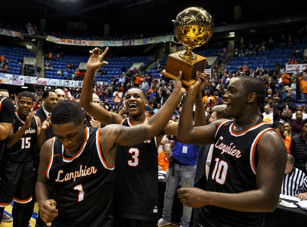 Lanphier's Yaakema Rose (1) Lanphier's Aundrae Williams (3) and Lanphier's Corrington Jones (10) hold up the trophy after the Lions defeated Southeast 60-49 in the championship game of the Boys City Basketball Tournament at the Prairie Capital Convention Center, Saturday, Jan. 21, 2017, in Springfield, Ill. Justin L. Fowler/The State Journal-Register