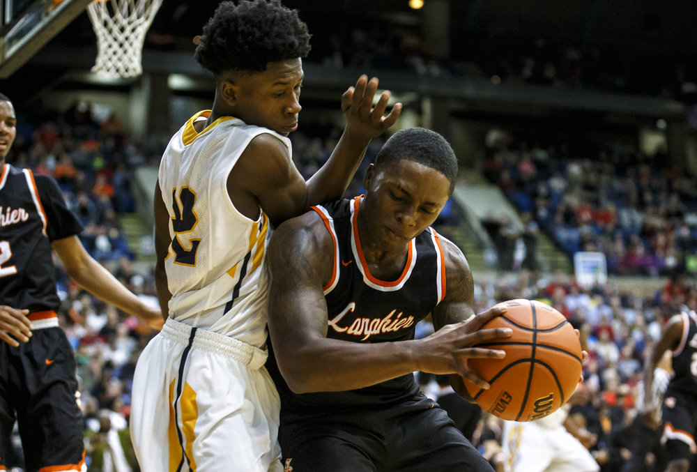 Lanphier's Yaakema Rose (1) collides with Southeast's Stepheon Sims (32) going for a loose ball in the second quarter of the championship game of the Boys City Basketball Tournament at the Prairie Capital Convention Center, Saturday, Jan. 21, 2017, in Springfield, Ill. Justin L. Fowler/The State Journal-Register