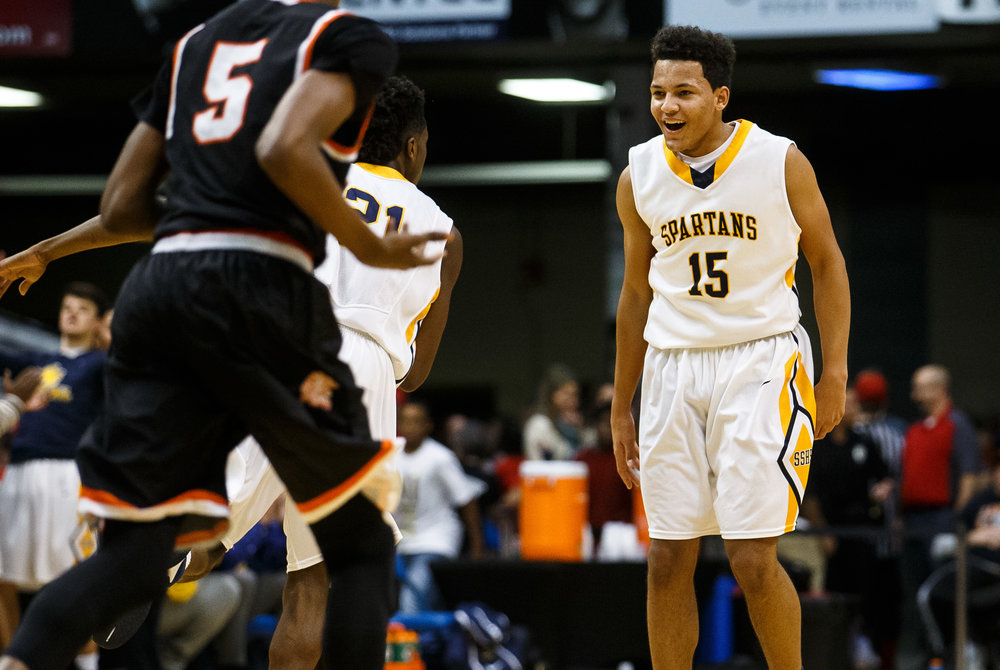Southeast's Jordan Stapleton (15) reacts after hitting a three against Lanphier in the first quarter of the championship game of the Boys City Basketball Tournament at the Prairie Capital Convention Center, Saturday, Jan. 21, 2017, in Springfield, Ill. Justin L. Fowler/The State Journal-Register