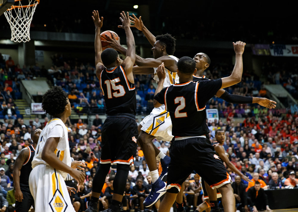 Southeast's Anthony Fairlee (21) drives into a crowded lane of Lanphier defenders in the second quarter of the championship game of the Boys City Basketball Tournament at the Prairie Capital Convention Center, Saturday, Jan. 21, 2017, in Springfield, Ill. Justin L. Fowler/The State Journal-Register
