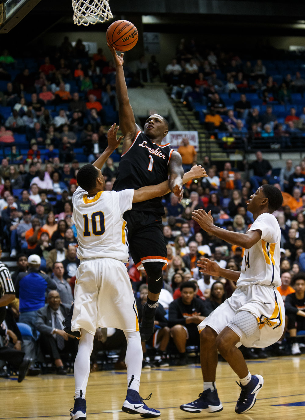 Lanphier's Yaakema Rose (1) with the lay-up over Southeast's Isaiah Walton (10) in the fourth quarter of the championship game of the Boys City Basketball Tournament at the Prairie Capital Convention Center, Saturday, Jan. 21, 2017, in Springfield, Ill. Justin L. Fowler/The State Journal-Register