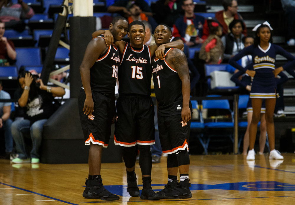 Lanphier's Corrington Jones (10), Stanley Morgan (15) and Lanphier's Yaakema Rose (1) start to celebrate as the Lions take down Southeast 60-49 in the championship game of the Boys City Basketball Tournament at the Prairie Capital Convention Center, Saturday, Jan. 21, 2017, in Springfield, Ill. Justin L. Fowler/The State Journal-Register