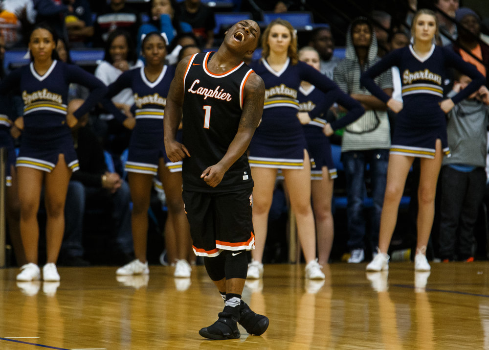 Lanphier's Yaakema Rose (1) celebrates as the buzzer sounds on the Lions 60-49 victory over Southeast in the championship game of the Boys City Basketball Tournament at the Prairie Capital Convention Center, Saturday, Jan. 21, 2017, in Springfield, Ill. Justin L. Fowler/The State Journal-Register