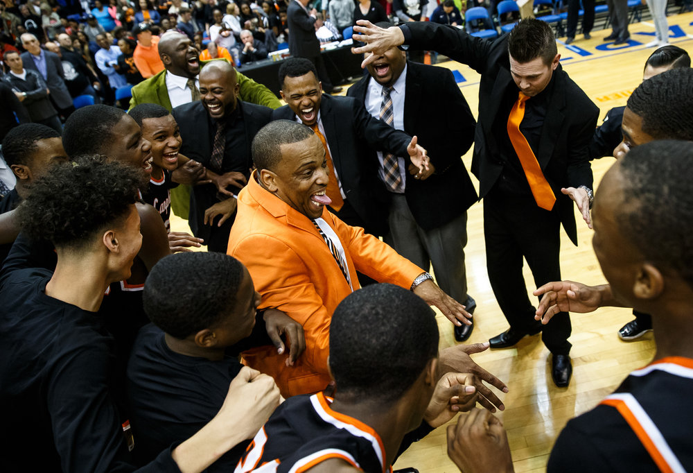 Lanphier boys basketball head coach Blake Turner celebrates with his team after the Lions defeated Southeast 60-49 in the championship game of the Boys City Basketball Tournament at the Prairie Capital Convention Center, Saturday, Jan. 21, 2017, in Springfield, Ill. Justin L. Fowler/The State Journal-Register