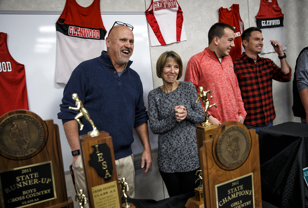 Glenwood Middle School cross country and track coaches Marc Kuhn, left, and Sue Zartler, center, get set to take a photo with former runners they coached that are now coaches themselves during a reception to honor their retirements at Glenwood Middle School, Sunday, Jan. 8, 2017, in Chatham, Ill. Zartler and Kuhn coached more than 2,500 students in 46 years combined and during their tenure Glenwood earned 27 top four finishes, including nine state championships. Justin L. Fowler/The State Journal-Register