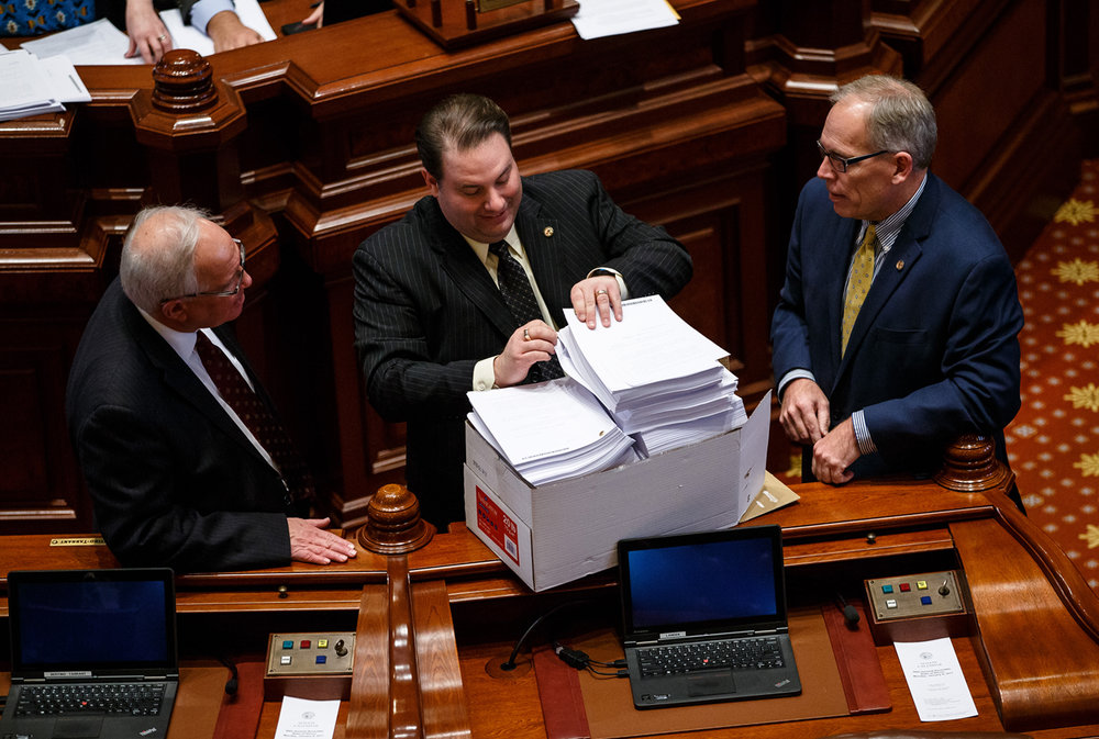 A package of amendments arrive on the Senate floor prior to both Democrats and Republicans going into caucus during the lame duck session at the Illinois State Capitol, Monday, Jan. 9, 2017, in Springfield, Ill. Justin L. Fowler/The State Journal-Register