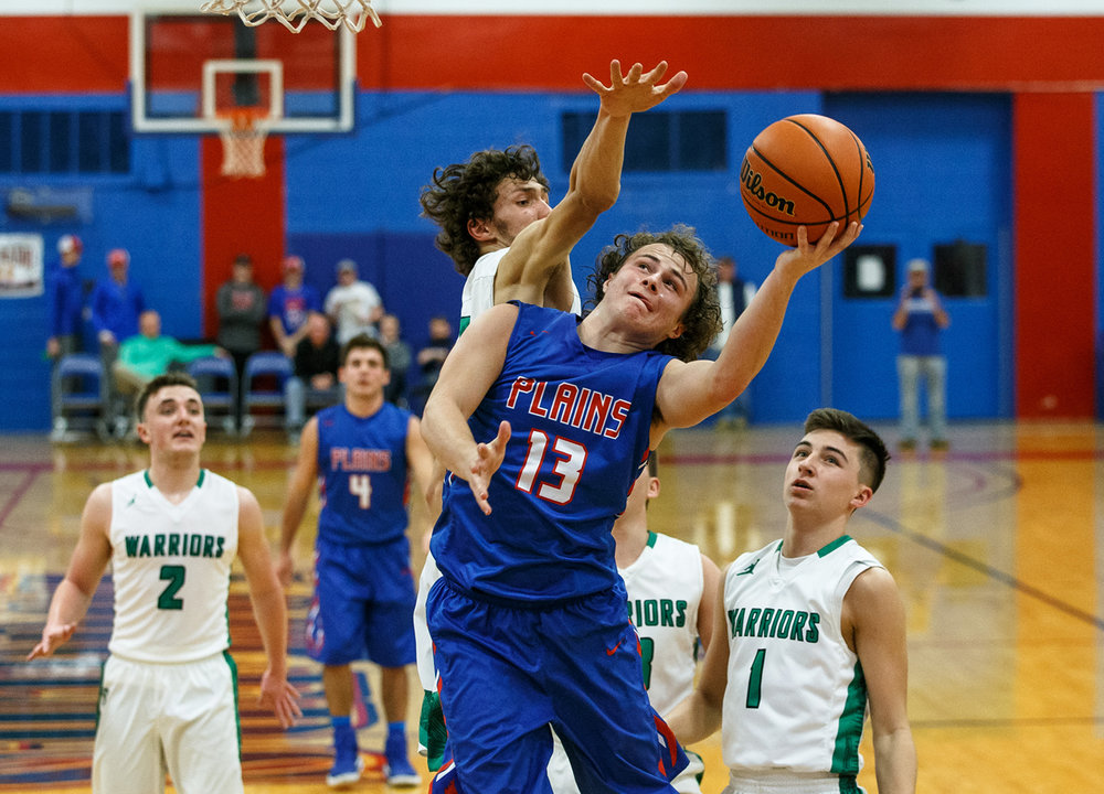 Pleasant Plains' Cole Greer (13) tries to get a shot off as he collides with Athens' Garrett Reichart (21) going up to the basket in the second half during the Sangamon County Tournament at Cass Gymnasium, Thursday, Jan. 12, 2017, in Springfield, Ill. Justin L. Fowler/The State Journal-Register