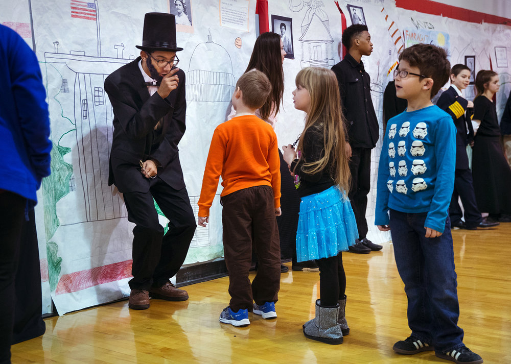 Devan Powell delivers his biographical sketch of Abraham Lincoln during the Civil War Heroes and Heroines Wax Museum at Springfield Ball Charter School Friday, Jan. 13, 2017. Students in the 7th. and 8th grades presented their sketches while dressed in costume in front of a full length informational drawing and answered questions from a steady stream of fellow students and visitors. Powell said Lincoln was first choice because they are both tall. Ted Schurter/The State Journal-Register