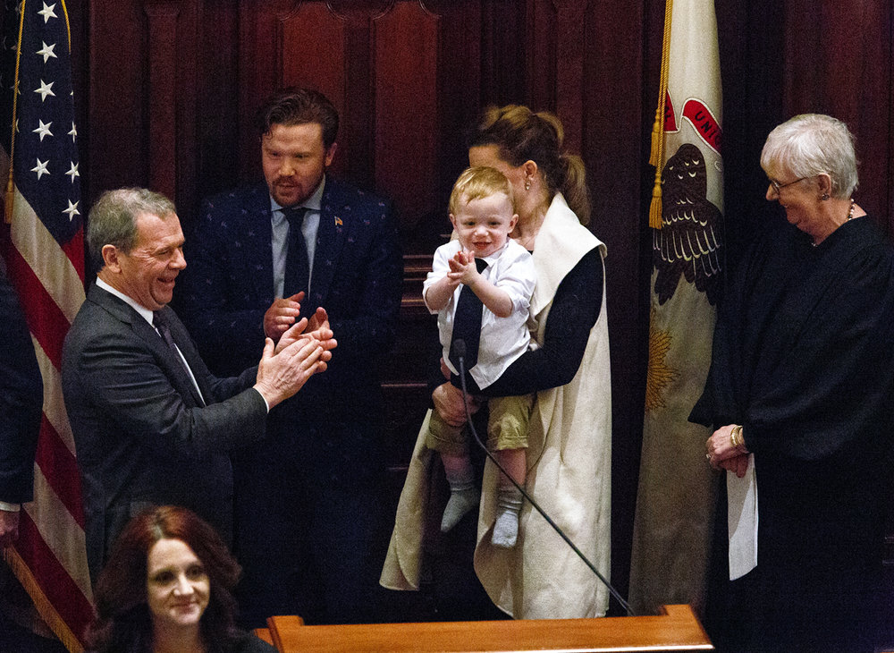 "Sen. John Cullerton, left, D-Chicago, applauds along with his new grandson, Cormack ""Mac"" Hooper, after Cullerton was sworn in as Senate President by Supreme Court Justice Mary Jane Theis during inauguration of the Senate as part of the 100th Illinois General Assembly at the Capitol in Springfield Wednesday, Jan. 11, 2017. Cullerton's son, Kyle, and his daughter Maggie Hooper, Mac's mother, accompanied the senator. Rich Saal/The State Journal-Register"