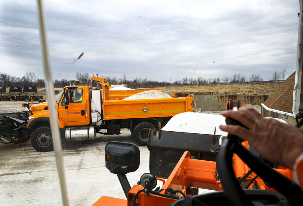 Salt trucks are loaded at the Illinois Department of Transportation maintenance facility in Litchfield Friday, Jan. 13, 2017. By noon,freezing rain had already begun to fall in southern Montgomery County and crews were pre-treating other roads in the area. Rich Saal/The State Journal-Register