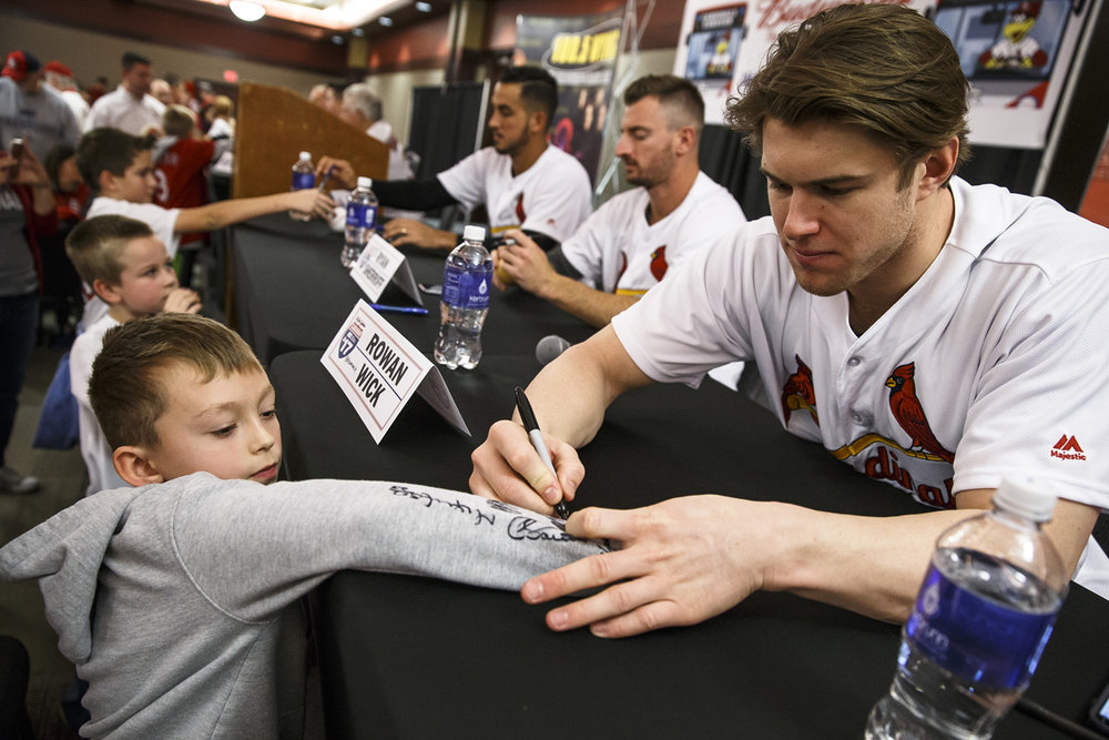 Cashton Conkrite, 9, of Williamsville, Ill., gets the sleeve of his sweatshirt signed by Cardinals pitcher Rowan Wick, right, during the 2017 Cardinals Caravan at the Prairie Capital Convention Center, Monday, Jan. 16, 2017, in Springfield, Ill. Justin L. Fowler/The State Journal-Register