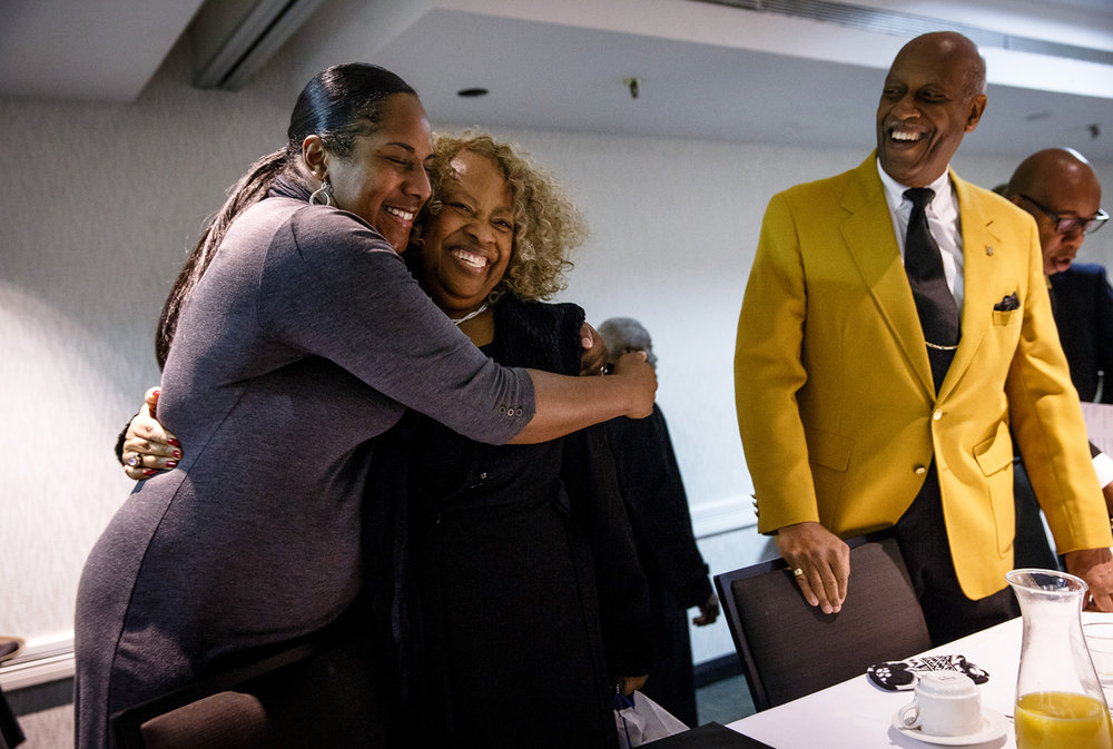 "Serita Lott, left, hugs Anna Jackson, center, the keynote speaker and lecturer with the English Dept. at SIU-C, whom which she has known since she was a child, during the 42nd Annual Dr. Martin Luther King Jr. Memorial Breakfast at the Wyndham Springfield City Centre, Monday, Jan. 16, 2017, in Springfield, Ill. Lott grew up near Carbondale, Ill., and went to youth career summer programs with Jackson. ""I haven't seen her since I moved to Springfield,"" said Lott. ""She still has the words of encouragement she used to give us when we were young."" Justin L. Fowler/The State Journal-Register"