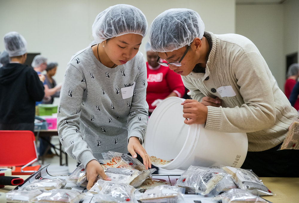 University of Illinois Springfield students Ngoc Vo, left, and Phuong Nguyen check food packets to ensure they don't leak before boxing them up at a meal-packaging event for Stop Hunger Now at the Student Life Building Monday, Jan. 16, 2017. Organizers planned to package 10,000 meals during the event. Ted Schurter/The State Journal-Register