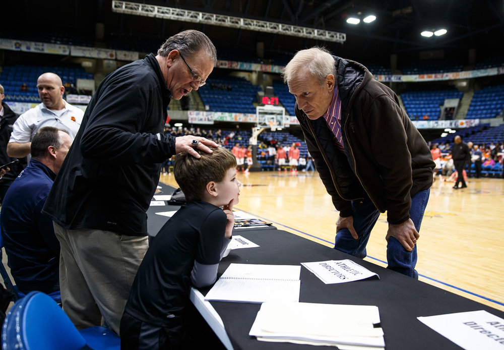 Illinois Governor Bruce Rauner talks with Sacred Heart-Griffin football head coach Ken Leonard along with his grandson, Blake, during the Boys City Basketball Tournament at the Prairie Capital Convention Center, Friday, Jan. 20, 2017, in Springfield, Ill. Justin L. Fowler/The State Journal-Register