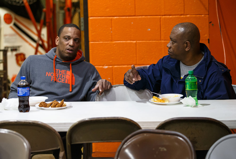 Lanphier head coach Blake Turner, left, and Southeast head coach Lawrence Thomas, right, sit down together for a meal prior to the third place game of the Girls City Basketball Tournament at Lanphier High School, Thursday, Jan. 26, 2017, in Springfield, Ill. Justin L. Fowler/The State Journal-Register